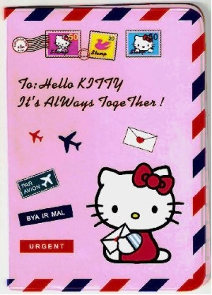 Picture of a Hello Kitty passport cover which is pink and has Hello Kitty on the front holding a letter.
